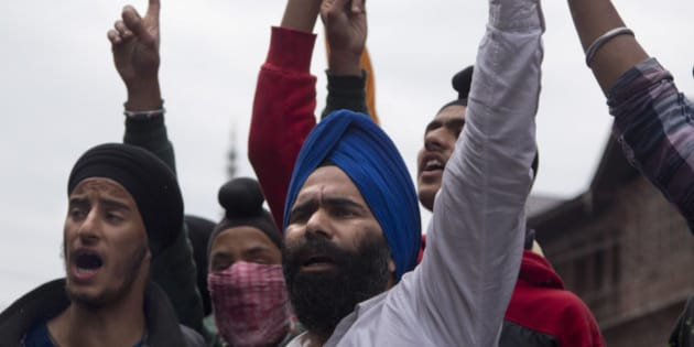 Sikhs shout slogans against Indian security forces during a protest in Srinagar, Friday, June 5, 2015. On Thursday, local authorities in Jammu removed posters of Sikh leader Jarnail Singh Bhindranwal triggering clashes between members of the Kashmiri Sikh and Indian security forces. (AP Photo/Dar Yasin)