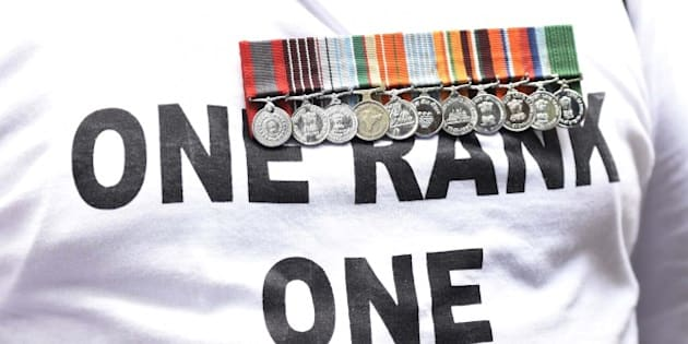 NEW DELHI, INDIA - AUGUST 23: A Retired army man with medals hanging on his chest during One Rank One Pension (OROP) protest at Jantar Mantar on August 23, 2015 in New Delhi, India. The ex-servicemen are hoping to meet Prime Minister Narendra Modi and have sought help from Defence Minister Manohar Parrikar for this. (Photo by Vipin Kumar/Hindustan Times via Getty Images)