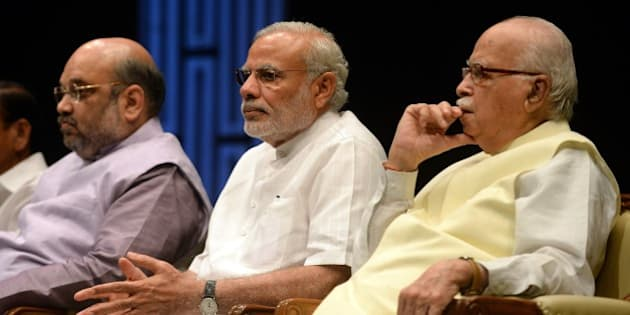 Indian Prime Minister Narendra Modi (C), Bharatiya Janata Party (BJP) President Amit Shah (L) and Senior BJP Leader L. K. Advani (R) attend the BJP parliamentary committee meeting at the parliament building in New Delhi on July 22, 2015. The three-week long monsoon session of the Indian parliament began on July 22,  with the ruling Bharatiya Janata Party's (BJP) intent on discussing three bills  land acquisition, goods and services (GST) tax, and revision of labour laws. AFP PHOTO / PRAKASH SINGH        (Photo credit should read PRAKASH SINGH/AFP/Getty Images)
