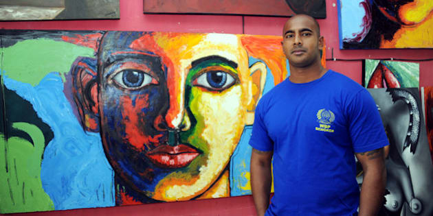 Australian drug smuggler Myuran Sukumaran, one of the so-called 'Bali Nine' gang, stands in front of his paintings at a prisoners studio in Kerobokan prison, Denpasar, on the Bali island on September 28, 2011. Sukumaran, who was arrested in 2005 for drug smuggling and sentenced to death, has lost his final appeal against the punishment. AFP PHOTO / SONNY TUMBELAKA (Photo credit should read SONNY TUMBELAKA/AFP/Getty Images)