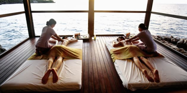 Couple getting side by side massages