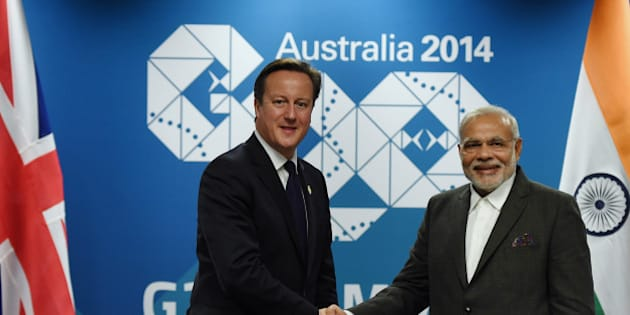 BRISBANE, AUSTRALIA - NOVEMBER 14:  British Prime minister David Cameron (left) shakes hands with Indian Prime Minister Narendra Modi during a bilateral meeting at the Brisbane Convention and Exhibitions Centre (BCEC) on November 14, 2014 in Brisbane Australia.   World leaders have gathered in Brisbane for the annual G20 Summit and are expected to discuss economic growth, free trade and climate change as well as pressing issues including the situation in Ukraine and the Ebola crisis. (Photo by Lukas Coch-Pool/Getty Images)