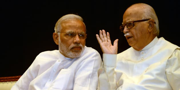 NEW DELHI,INDIA APRIL 21: Prime Minister Narendra Modi with veteran BJP leader LK Advani during the BJP parliamentary board meeting in New Delhi.(Photo by Praveen Negi/India Today Group/Getty Images)