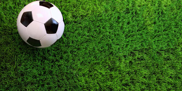 green grass soccer field. Soccer Ball On Green Grass Soccer Field