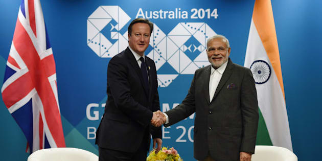 British Prime Minister David Cameron, left, shakes hands with Indian Prime Minister Narendra Modi during a bilateral meeting at the Brisbane Convention and Exhibitions Centre, ahead of the G-20 summit in Brisbane, Friday, Nov. 14, 2014. Brisbane is playing host to top officials from the 20 biggest industrialized and developing economies for a two day meeting from Saturday Nov.15.   (AP Photo/Lukas Coch,Pool)