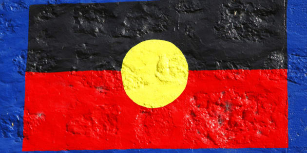 Aboriginal flag painted on stone wall. Official flag of indigenous people of Australia Aborigines also called Aboriginal Australians. South Australia.
