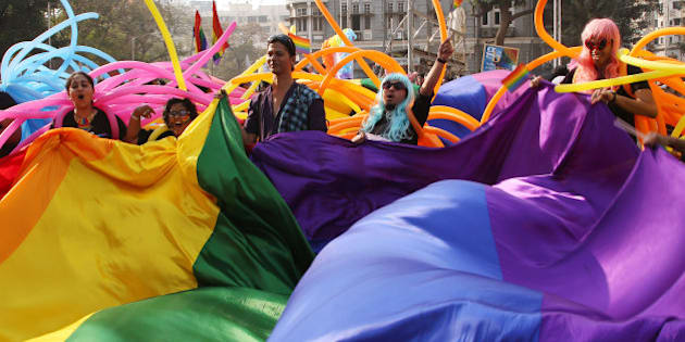 Supporter of the lesbian, gay, bisexual and transgender community wave a rainbow flag during a gay pride parade in Mumbai, India, Saturday, Jan. 31, 2015. Gay rights supporters waved flags and danced during the march to celebrate gay pride and to push for the repeal of a colonial-era law that makes homosexuality a crime. (AP Photo/Rajanish Kakade)