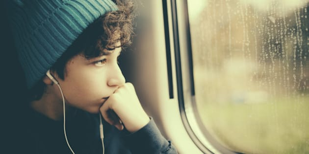 Pensive Girl on Train looking through window