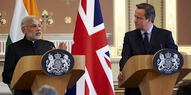 India's Prime Minister Narendra Modi (L) and British Prime Minister David Cameron give a joint press conference at the Foreign Office in London on November 12, 2015. India's Prime Minister Narendra Modi will meet Britain's Queen Elizabeth II and address a huge rally at London's Wembley Stadium during a three-day visit to Britain focused on trade and investment starting today. 