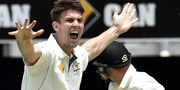 Australia's paceman Mitchell Marsh (L) shouts a successful leg-before-wicket appeal against New Zealand's Doug Bracewell (R) during the fifth and the final day of the first Test cricket match between Australia and New Zealand in Brisbane on November 9, 2015. AFP PHOTO / Saeed KHAN --IMAGE RESTRICTED TO EDITORIAL USE - NO COMMERCIAL USE--        (Photo credit should read SAEED KHAN/AFP/Getty Images)
