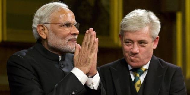 LONDON, UNITED KINGDOM - NOVEMBER 12:  Indian Prime Minister Narendra Modi acknowledges applause next to Speaker of the House of Commons John Bercow after addressing members of parliament and invited guests in the Royal Gallery at the Houses of Parliament during an official three day visit on November 12, 2015 in London, England. In his first trip to Britain as Prime Minister Modi's visit will aim to develop economic ties between the two countries. In a busy schedule he is due to speak at Wembley Stadium, lunch with the Queen at Buckingham Palace, address Parliament and stay overnight at Chequers. (Photo by Justin Tallis - WPA Pool/Getty Images)