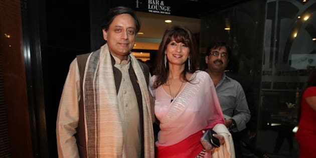 NEW DELHI, INDIA - MARCH 26: Member of Parliament Shashi Tharoor and his wife Sunanda attends a promotional event to unveil the new issue of Stardust Magazine at F-Bar, Hotel Ashok on March 26, 2012 in New Delhi, India. (Photo by Raajeesh Kashyap / Hindustan Times via Getty Images)