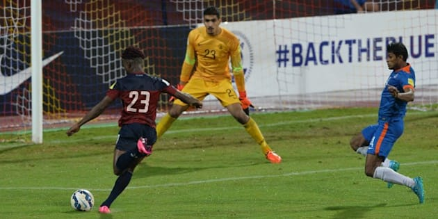 India's goalie Gurpreet Singh Sandhu (C) and player Arnad Kumar Mondal (R) look on as Guam's Shane Andre Malcom attempts a strike towards the goal during the the Asia Group D FIFA World Cup 2018 qualifying football match between India and Guam at The Sree KanteeraVa Stadium in Bangalore on November 12, 2015.  AFP PHOTO/ Manjunath KIRAN        (Photo credit should read Manjunath Kiran/AFP/Getty Images)