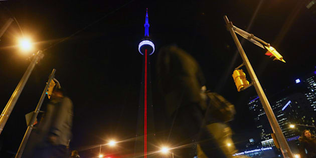 TORONTO, ON - NOVEMBER 13 - The CN Tower lit up with the colours of the French Flag in support of France in the face of tragedy, on November 13, 2015        (Cole Burston/Toronto Star via Getty Images)