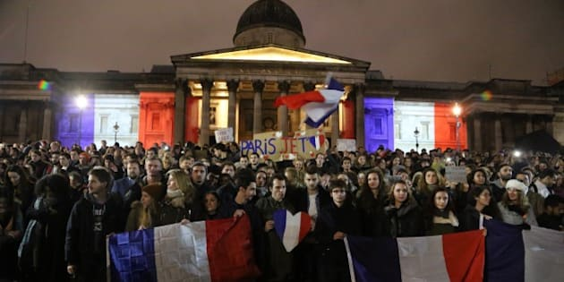 LONDON, ENGLAND - NOVEMBER 14: The National Portrait Gallery lit up in the colours of the French national flag during a vigil to pay respect to the victims of France terror attacks, at Trafalgar Square, London on November 14, 2015. At least 129 people were killed and 352 others injured -- 99 of them in critical condition -- after the terror attacks in Paris on 13 November. (Photo by Tayfun Salci/Anadolu Agency/Getty Images)