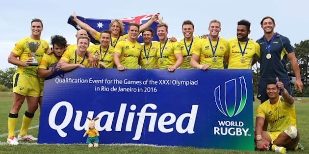 AUCKLAND, NEW ZEALAND - NOVEMBER 15:  Australian players celebrate after winning the World Sevens Oceania Olympic Qualification Final between Australia and Tonga on November 15, 2015 in Auckland, New Zealand.  (Photo by Simon Watts/Getty Images)