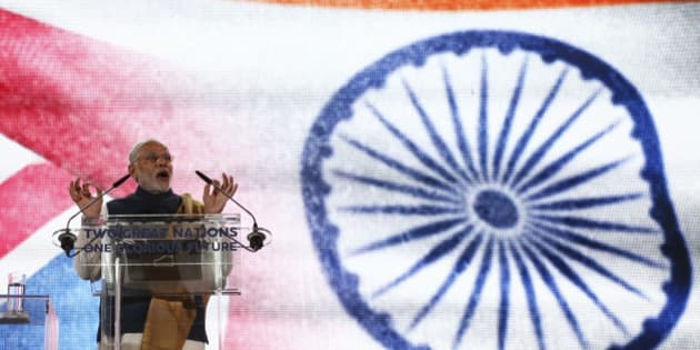 LONDON, UNITED KINGDOM - NOVEMBER 13: India's Prime Minister Narendra Modi speaks on stage at Wembley Stadium during a welcome rally on November 13, 2015, in London, England. In his first trip to Britain as Prime Minister Modi's visit will aim to develop economic ties between the two countries. In a busy schedule he is due to speak at Wembley Stadium, have lunch with the Queen at Buckingham Palace, address Parliament and stay overnight at Chequers. (Photo by Justin Tallis - WPA Pool/Getty Images)