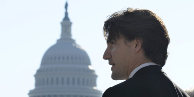 With the Capitol dome in the background, Canadian Liberal Leader Justin Trudeau speaks to reporters during his first official visit to Washington since becoming Liberal Leader, Friday, Oct. 25, 2013, in Washington. (AP Photo/Susan Walsh)