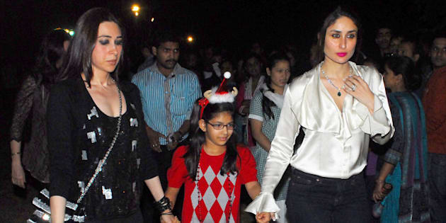 MUMBAI, INDIA - DECEMBER 24: Indian bollywood actresses Kareena Kapoor and Karisma Kapoor with her daughter came out to St. Andrews Church in Bandra for Christmas celebrations on December 24, 2012 in Mumbai, India. (Photo by Prodip Guha/Hindustan Times via Getty Images)