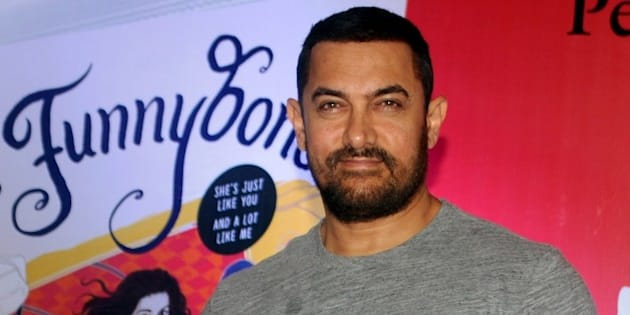 Indian Bollywood actor Aamir Khan poses for a photograph during the launch of the 'Miss Funnybones' book written by actress, columnist and interior designer Twinkle Khanna in Mumbai on late August 18, 2015. AFP PHOTO / STR        (Photo credit should read STRDEL/AFP/Getty Images)
