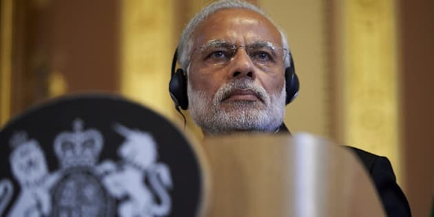 India's Prime Minister Narendra Modi takes part in a joint press conference with British Prime Minister David Cameron (not pictured) at the Foreign Office in London on November 12, 2015. India's Prime Minister Narendra Modi will meet Britain's Queen Elizabeth II and address a huge rally at London's Wembley Stadium during a three-day visit to Britain focused on trade and investment starting today.  AFP PHOTO / NIKLAS HALLE'N        (Photo credit should read NIKLAS HALLE'N/AFP/Getty Images)