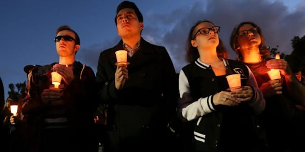 LONG BEACH, CA - NOVEMBER 15: Students and mourners hold candles to honor Nohemi Gonzalez, 23, who was killed during the attacks in Paris, on November 15, 2015 in Long Beach, California. Gonzalez, from El Monte, California, was a senior at CSULB studying design and attending Strate College of Design during a semester abroad program. At least 129 peope died on November 13 when three teams of terrorists attacked multiple locations around Paris. (Photo by Sandy Huffaker/Getty Images)