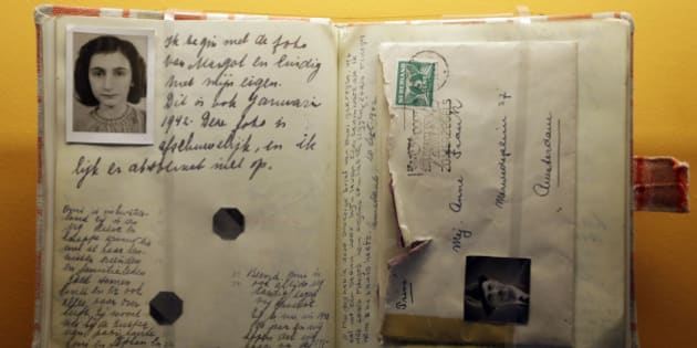 In this Monday, March 18, 2013 photo, a replica of the Anne Frank Diary is displayed at the Indianapolis Children's Museum in Indianapolis. A sapling grown from seeds taken from the massive chestnut tree that stood outside the home in which Frank and her family hid will be planted in the museum's Peace Park will stand next to a limestone carving of a podium with Anne's diary on it. (AP Photo/Michael Conroy)