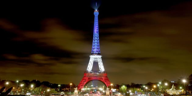PARIS, FRANCE - NOVEMBER 16:  The Eiffel Tower is illuminated in Red, White and Blue in honour of the victims of Friday's terrorist attacks on November 16, 2015 in Paris, France. Countries across Europe joined France today to observe a one minute-silence in an expression of solidarity with the victims of the terrorist attacks, which left at least 129 people dead and hundreds more injured. on November 16, 2015 in Paris, France.  (Photo by Pierre Suu/Getty Images)