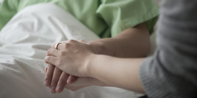 holding man patient hand