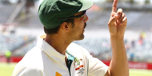 PERTH, AUSTRALIA - NOVEMBER 16: Mitchell Johnson of Australia points to the scoreboard while walking from the field during day four of the second Test match between Australia and New Zealand at WACA on November 16, 2015 in Perth, Australia.  (Photo by Paul Kane/Getty Images)