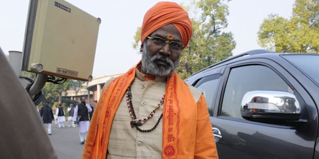NEW DELHI, INDIA - DECEMBER 16: BJP MP Sakshi Maharaj after attending Parliament Board Meeting at Library Hall on December 16, 2014 in New Delhi, India. Lok Sabha passed a bill to regularise unauthorized colonies and rehabilitate slum dwellers in poll-bound Delhi.( Photo by Sonu Mehta/Hindustan Times via Getty Images)