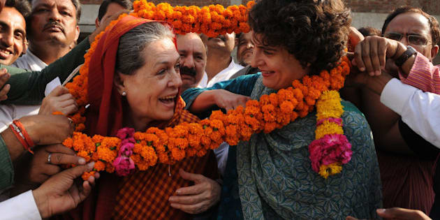 RAE BARELI, INDIA - MAY 28: Congress President Sonia Gandhi and daughter Priyanka Gandhi welcomed by local people and getting feedback about their problems on May 28, 2015 in Rae Bareli, India. On a tour of her Lok Sabha constituency Rae Bareli, Congress President Sonia Gandhi accused the Centre of showing apathetic attitude towards her constituency, days after Rahul Gandhi alleged that the Modi government was pursuing politics of vendetta against them. (Photo by Ashok Dutta/Hindustan Times via Getty Images)
