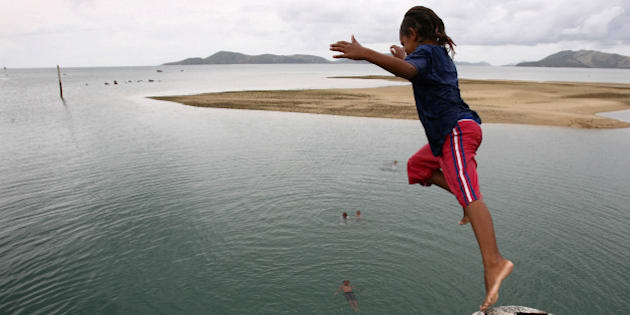 (AUSTRALIA & NEW ZEALAND OUT) Local children fill in their spare time by jumping off the pier on Palm Island in northern Queensland, 18 January 2007. THE AGE Picture by PAUL HARRIS (Photo by Fairfax Media/Fairfax Media via Getty Images)