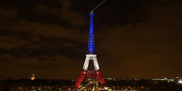 A photo taken on November 16, 2015 in Paris shows the Eiffel Tower illuminated with the colours of the French national flag in tribute to the victims of November 13 Paris terror attacks which killed at least 129 people in scenes of carnage at a concert hall, restaurants and the national stadium. AFP PHOTO / ERIC FEFERBERG        (Photo credit should read ERIC FEFERBERG/AFP/Getty Images)