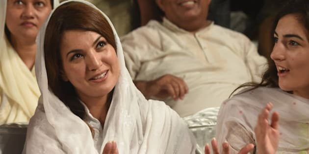 Reham Khan, wife of Pakistani opposition leader Imran Khan is pictured during his husband's campaign meeting ahead of the by-election for NA-122 (a constituency for the National Assembly of Pakistan) to be held on October 11 in Lahore on October 4, 2015.  AFP PHOTO / Arif ALI        (Photo credit should read Arif Ali/AFP/Getty Images)