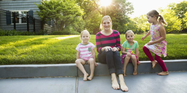 Portrait of babysitter and little girls