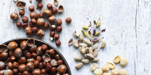 A selection of nuts on wood background