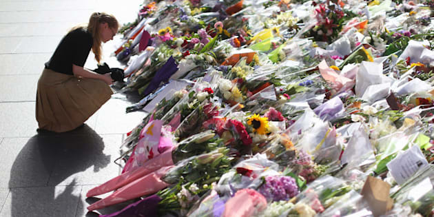 SYDNEY, AUSTRALIA - DECEMBER 17:  Flowers are left as a sign of respect at Martin Place on December 17, 2014 in Sydney, Australia. Sydney siege gunman Man Haron Monis, was shot dead by police in the early hours of Tuesday morning after taking hostages at the Lindt Chocolat Cafe in Martin Place. Two other people died, 33-year-old cafe manager Tori Johnson and 38-year-old Sydney barrister Katrina Dawson.  (Photo by Joosep Martinson/Getty Images)