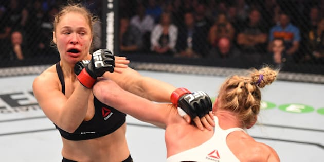 MELBOURNE, AUSTRALIA - NOVEMBER 15:  (R-L) Holly Holm of the United States punches Ronda Rousey of the United States in their UFC women's bantamweight championship bout during the UFC 193 event at Etihad Stadium on November 15, 2015 in Melbourne, Australia. (Photo by Josh Hedges/Zuffa LLC/Zuffa LLC via Getty Images)