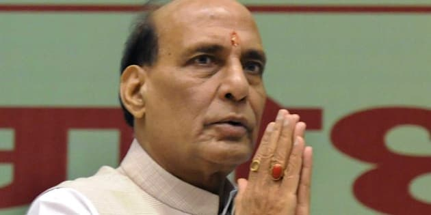 NEW DELHI, INDIA - AUGUST 8: Home Minister Rajnath Singh during the 'Swadeshi Govansh Par Aadharit Swasthya Avam Rashtriya Swavlamban Sanoshthi' or conference on conservation of cow, organised by Rashtriya Godhan Mahasangh, in association with the agriculture ministry, at Vigyan Bhavan on August 8, 2015 in New Delhi, India. Singh said that as a home minister he has ensured that cattle smuggling to Bangladesh was checked with continued efforts by Border Security Force (BSF) personnel. He said the government has allocated Rs. 500 crore for cow conservation and two centres have been set up to for conducting research on cows of Indian breed. (Photo by Mohd Zakir/Hindustan Times via Getty Images)