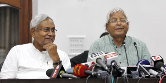 PATNA, INDIA - NOVEMBER 8: Janata Dal-United (JD-U) leader Nitish Kumar and Rashtriya Janta Dal leader Lalu Prasad Yadav during a press conference after landslide victory in Bihar Assembly elections at Nitish Kumar's residence, on November 8, 2015 in Patna, India. Nitish Kumar said, 'I express my gratitude towards people of Bihar, will try our best to match up with their expectations. We respect our opposition in Bihar; want to work in consensus with everyone to develop Bihar. This victory is big win and we will work towards the grand alliances mandate for the development of Bihar.' Lalu Yadav said, 'BJP had its eyes on Kolkata, the capital of West Bengal. It wanted to move eastwards. Bihar stopped them in tracks. PM Narendra Modi is nothing but an RSS pracharak.' The grand alliances victory is also attributed to the rejection of communal politics, driven mostly by the recent debate over cow slaughter and consumption of beef. Data from the election commission's website for 240 of the state's 243 seats showed the RJD-JD(U)-Congress alliance led in 178 seats, an emphatic victory over the NDA that could only win around 59 seats. (Photo by Ajay Aggarwal/Hindustan Times via Getty Images)