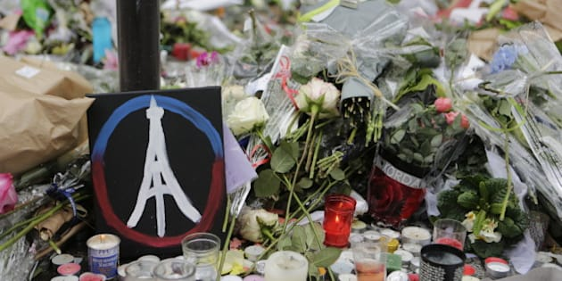 LE PETIT CAMBODGE, PARIS, ÎLE-DE-FRANCE, FRANCE - 2015/11/17: A painted peace sign with the Eiffel Tower in it has been placed at the memorial outside the restaurant Le Petit Cambodge for the people killed here during the Paris attacks. Parisians and tourists continue to visit the memorials for the people killed in the terrorists attacks in Paris, to lay down flowers and candles and to pay their respect. Over 130 people have been by terrorist from the Islamic State. (Photo by Michael Debets/Pacific Press/LightRocket via Getty Images)
