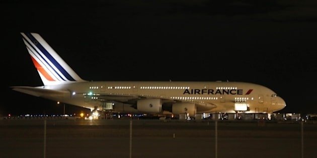 Air France Airbus 380, Flight 65,  sits on the runway at the Salt Lake City International Airport being inspected by the FBI on November 17, 2015 in Salt LAke City, Utah. Two Air France flights bound for Paris from the United States were diverted November 17, 2015 and landed safely after the airline received anonymous bomb threats, the carrier said.  Flight 65 from Los Angeles and Flight 55 from Washington were 'subject to anonymous threats received after their respective takeoff,' the airline said in a statement.   AFP PHOTO / GEORGE FREY        (Photo credit should read GEORGE FREY/AFP/Getty Images)