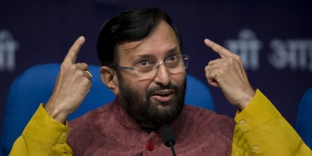 Indian Environment Minister, Prakash Javadekar, addresses journalists at  a press conference to elaborate upon India's submission for a global climate pact to cut down on the intensity of its carbon emissions, in New Delhi, India, Friday, Oct. 2, 2015. India has pledged to slash the rate of emissions relative to gross domestic product by 33-35 percent by 2030 from 2005 levels. (AP Photo/Saurabh Das)