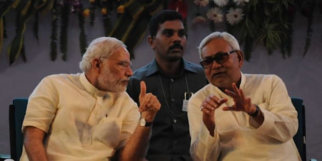 PATNA, INDIA - JULY 25: Prime Minister Narendra Modi interacts with Bihar Chief Minister Nitish Kumar at 87th ICAR (Indian Council of Agricultural Research) Foundation Day Celebrations, SKM Hall, on July 25, 2015 in Patna, India. Modi said the nation can no longer wait for the second green revolution, which must come from eastern India.  He said India must aim to become totally self-sufficient in the agriculture sector. During a rally, Modi targeted Bihar Chief Minister Nitish Kumar for allying with RJD, saying he was trying to drag the state back to the 'jungle raj', and asked the voters to reject such people as they 'cannot be trusted' again and elect NDA with a two-third majority for changing Bihar's fate. (Photo by AP Dube/Hindustan Times via Getty Images)