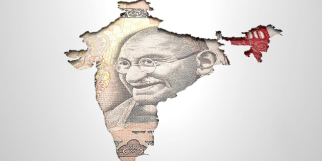 The shape of the country of India in the colours of its national rupee currency recessed into an isolated white surface