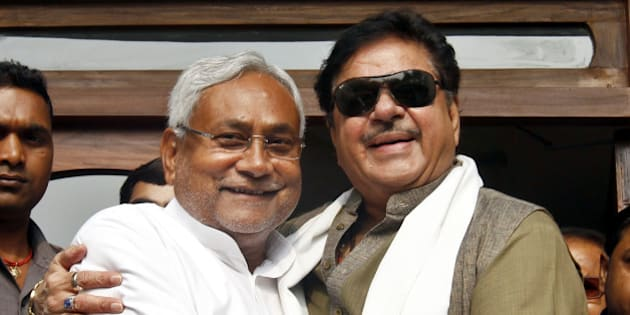 PATNA, INDIA - NOVEMBER 9: India film actor and BJP leader Shatrughan Sinha meets JD(U) leader and Bihar Chief Minister Nitish Kumar a day after the grand alliance swept the state assembly polls on November 9, 2015 in Patna, India. The newly-formed JD(U)-RJD-Congress alliance defeated Narendra Modi led NDA alliance by securing 178 seats in the 243-member House. RJD emerged the leader of the pack with 80 seats while JD(U) bagged 71 in the recently-concluded Bihar polls. (Photo by Ajay Aggarwal/Hindustan Times via Getty Images)