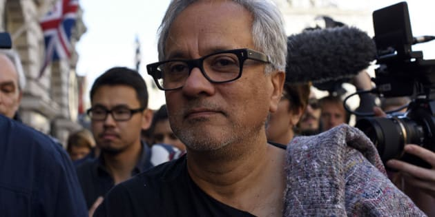 LONDON, ENGLAND - SEPTEMBER 17:  Anish Kapoor walks through the city as part of a march in solidarity with migrants currently crossing Europe on September 17, 2015 in London, England. Each artist carried a single blanket symbolizing the needs that face migrants coming to Europe.  (Photo by Ben Pruchnie/Getty Images)