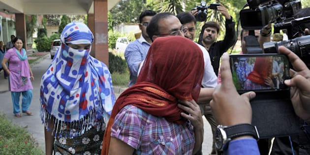 NEW DELHI, INDIA - SEPTEMBER 9: The two Nepalese women who were allegedly harassed by Saudi diplomat in Gurgaon, at Nepal embassy on September 9, 2015 in New Delhi, India. Two Nepalese maids have accused a Saudi diplomat of rape and torture while they were working in his home at Gurgaon on the outskirts of the national capital after which local police filed an FIR in the matter. The Nepal ambassador said that the Nepal embassy is in touch with the MEA and local police authorities sought detailed report on the incident. (Photo by Sushil Kumar/Hindustan Times via Getty Images)