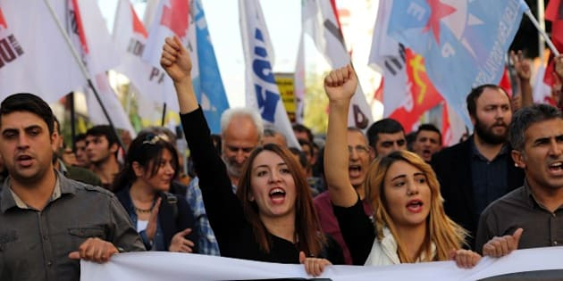 Members of Turkish leftist movements shout slogans during an anti-G20 protest in Antalya, on November 15, 2015.  Leaders from the world's top 20 industrial powers meet in Turkey from November 15 seeking to overcome differences on a range of issues including the Syria conflict, the refugee crisis and climate change.  AFP PHOTO / ADEM ALTAN        (Photo credit should read ADEM ALTAN/AFP/Getty Images)